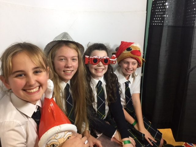 Photograph of pupils in photo booth at PSC Christmas Fayre